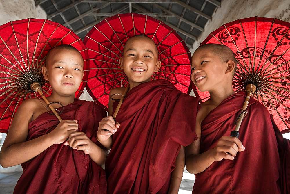 Teen Buddhist monks in Burma in Bagan city in Sweshigone pagoda