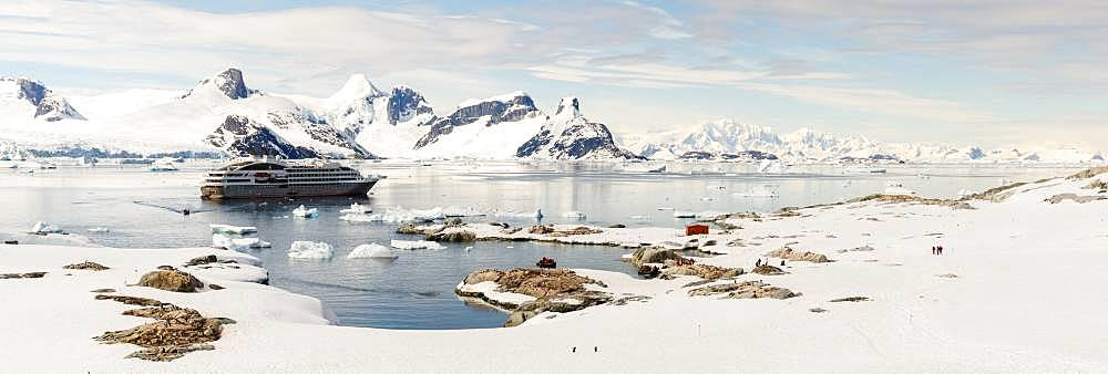 Landings of passengers on a cruise on Petermann Island, Antarctic Peninsula, Antarctica