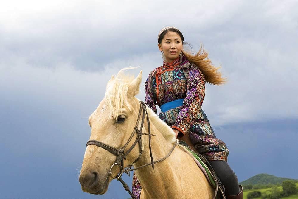 Mongolian woman with her horse, Bashang Grassland, Zhangjiakou, Hebei Province, Inner Mongolia, China