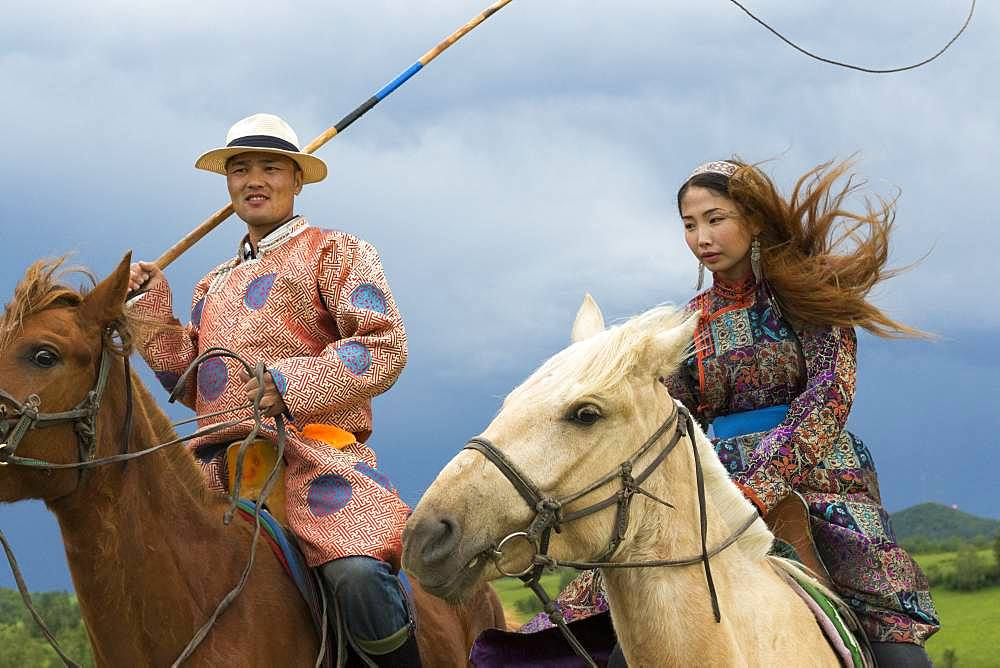Mongol on a horse, with a catch lasso, Zhangjiakou, Bashang Grassland, Hebei Province, Inner Mongolia, China