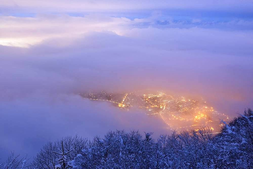 Stratus on the Geneva basin at dusk. Lights of Collonges-sous-Saleve seen from Mont Saleve, Haute-Savoie, Alps, France
