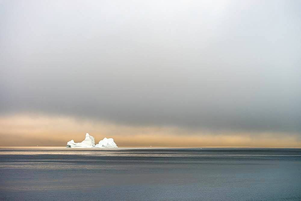 Iceberg drifting at sunrise in Disko Bay, Greenland
