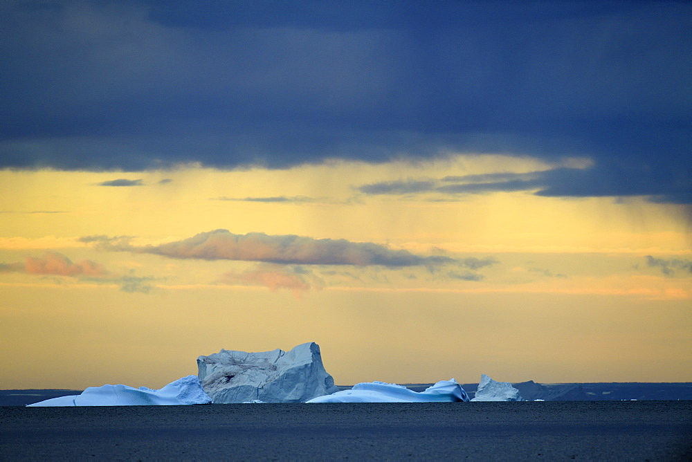 Iceberg at sunset in Scoresby Sund, It will soon be more than drifting ice pieces, Greenland