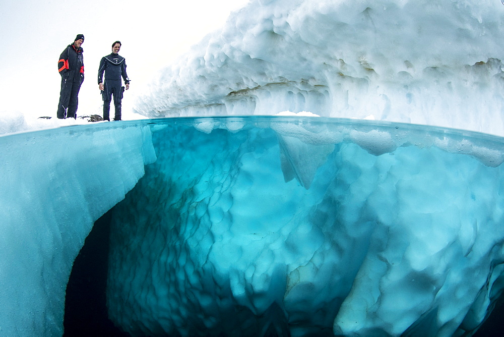 Split image of scuba divers before to dive under the ice, only in springtime, when the hard winter slowly subsides, are the ice-cold waters suitable for divers who can dive around a iceberg that floats in crystal-clear water, Tasiilaq, East Greenland