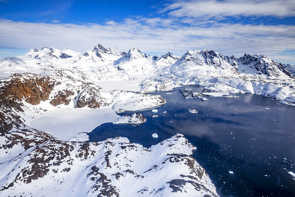 Panoramic view from helicopter, coast with mountains and sea, around Tasiilaq, East Greenland