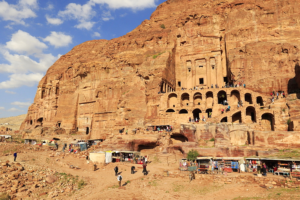 Many tourists visiting the tomb of the urn in the ancient city of Petra, Jordan