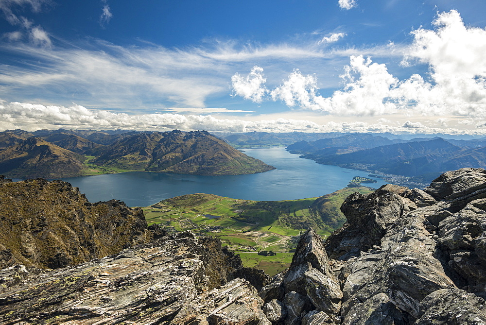 View from Remarkables mountain range on Lake Wakatipu with city of Queenstown, South Island, New Zealand