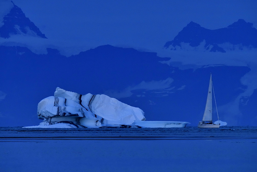 Sailboat passing in Scoresbysund, North East Greenland