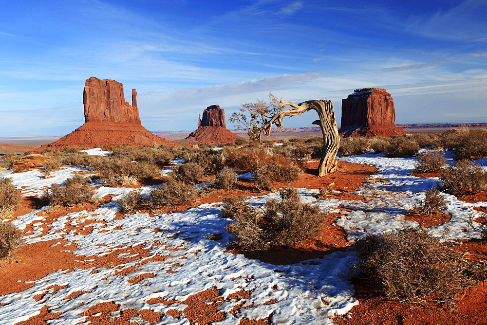 Monument Valley rocks stones Mitten Buttes and Merrick's Butte formed by weathering in snow winter erosion United States United States of America North America America