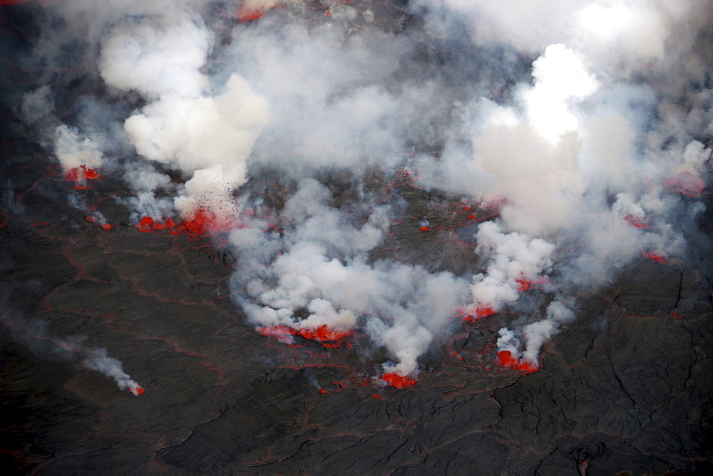 volcano Nyiragongo crater with lava fountains in the lava lake rising smoke nature natural phenomenon Kongo Afrika
