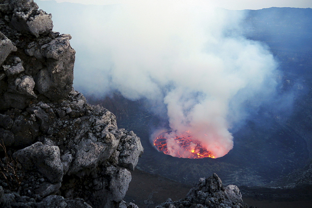 volcano Nyiragongo crater with lava lake rising smoke nature natural phenomenon