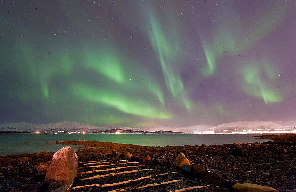 northern lights Aurora Borealis on the beach coast Tromso Kvaloya Troms county Nature Scenery