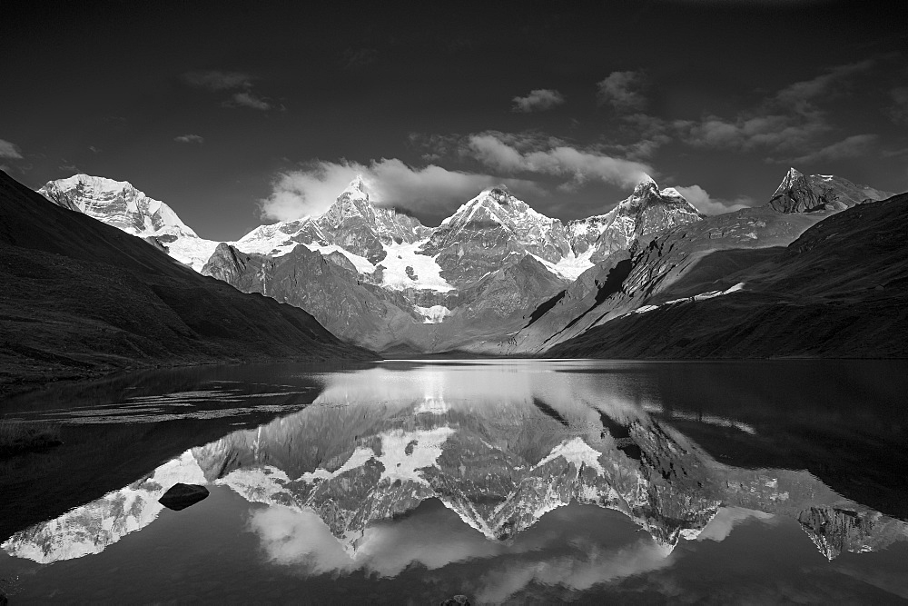 Andes mountains mountain Yerupaja 6635 m and Yerupaja Chico 6121 m partially covered with snow mountain lake in front with water surface reflection sunrise natural mood - 869-5276