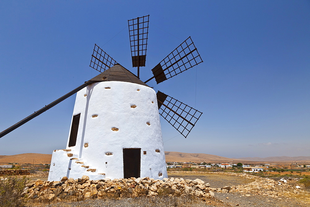 white solid stone mill windmill Pueblo Los Llanos de la Concepcion with six wings without fabric cover seen against blue cloudless sky outdoors calendar motif Fuerteventura Island Province Las Palmas Canary Islands Spain Europe