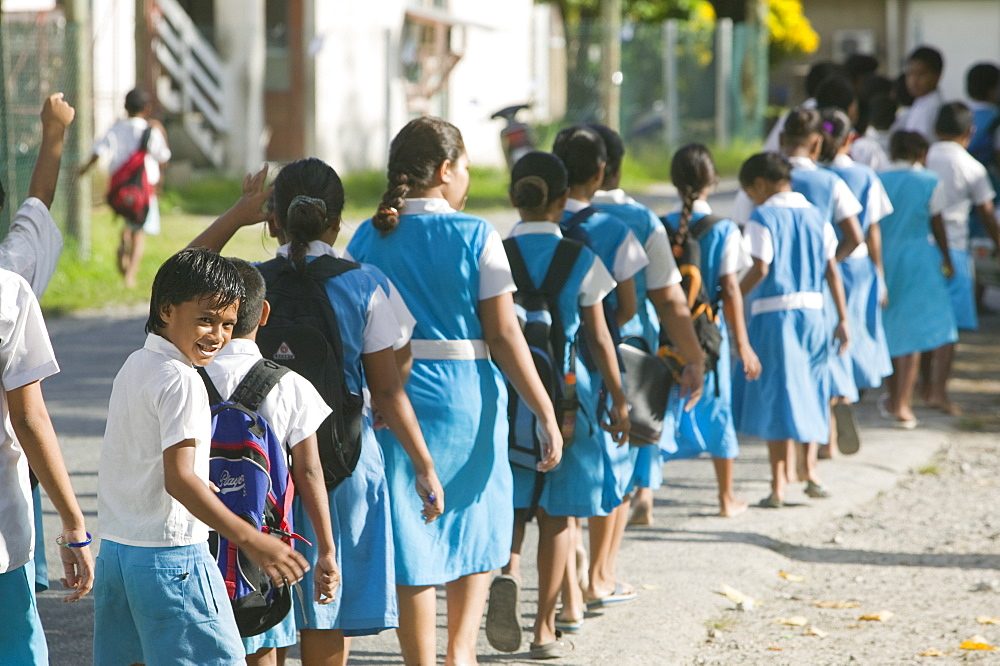 Children walking to school on Funafuti Atoll, Tuvalu, Pacific