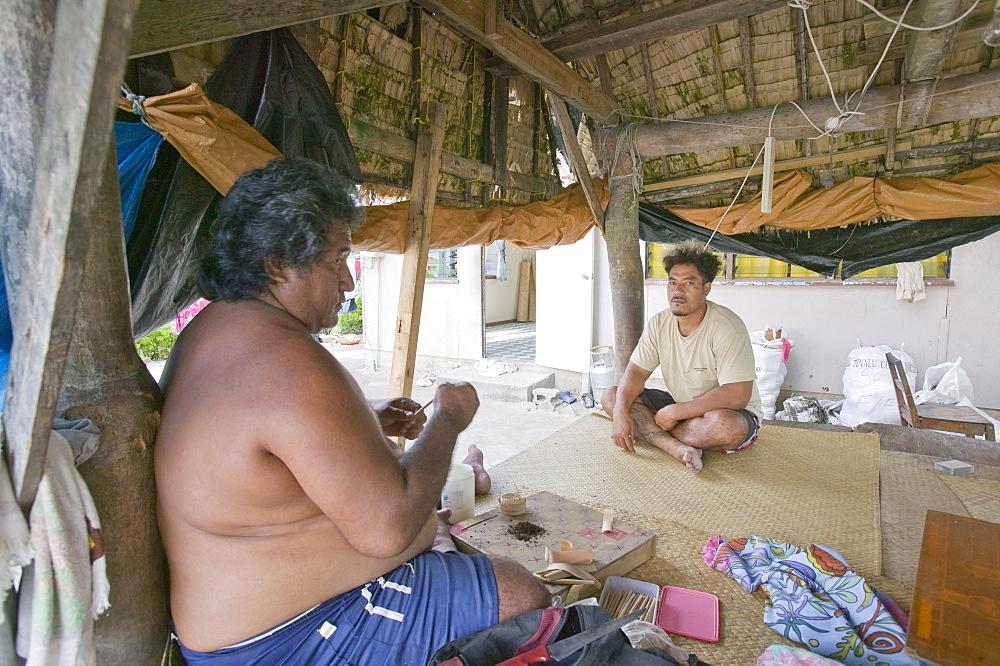 A Tuvaluan man making home made cigarettes on Funafuti Atoll, Tuvalu, Pacific