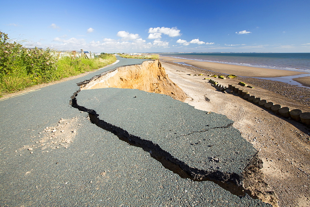 A collapsed coastal road at between Skipsea and Ulrome on Yorkshires East Coast, near Skipsea, UK. The coast is composed of soft boulder clays, very vulnerable to coastal erosion. This sectiion of coast has been eroding since Roman times, with many villages having disappeared into the sea, and is the fastest eroding coast in Europe. Climate change is speeding up the erosion, with sea level rise, increased stormy weather and increased heavy rainfall events, all palying their part.
