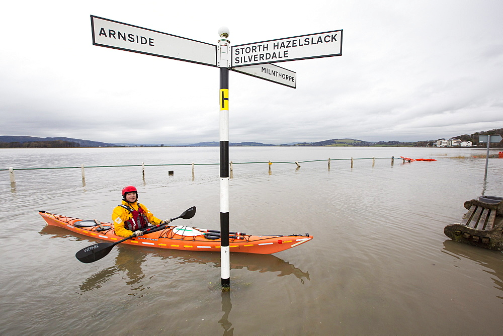 Kayakers in the flood waters on the road at Storth on the Kent Estuary in Cumbria, UK, during the January 2014 storm surge and high tides.