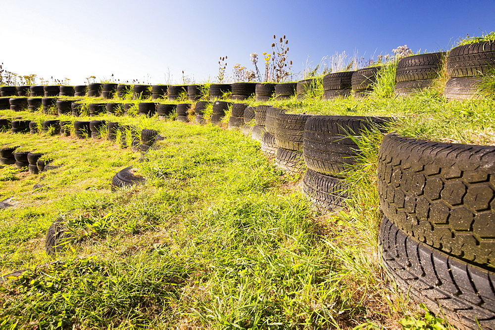 An ampitheatre built with used tyres at Mount Pleasant Ecological Park, Porthtowan, Cornwall, UK.