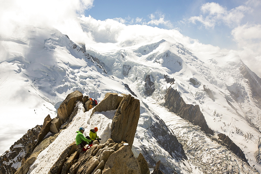 Mont Blanc from the Aiguille Du Midi above Chamonix, France, with climbers on the Cosmiques Arete.