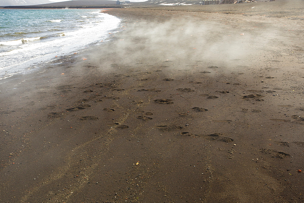 Deception Island in the South Shetland Islands off the Antarctic Peninsular is an active volcanic caldera, the beach is steaming from the geothermal heat.