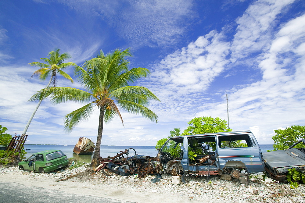 A ship, car and van wrecked by Hurricane Bepe on Funafuti Atoll, Tuvalu, Pacific
