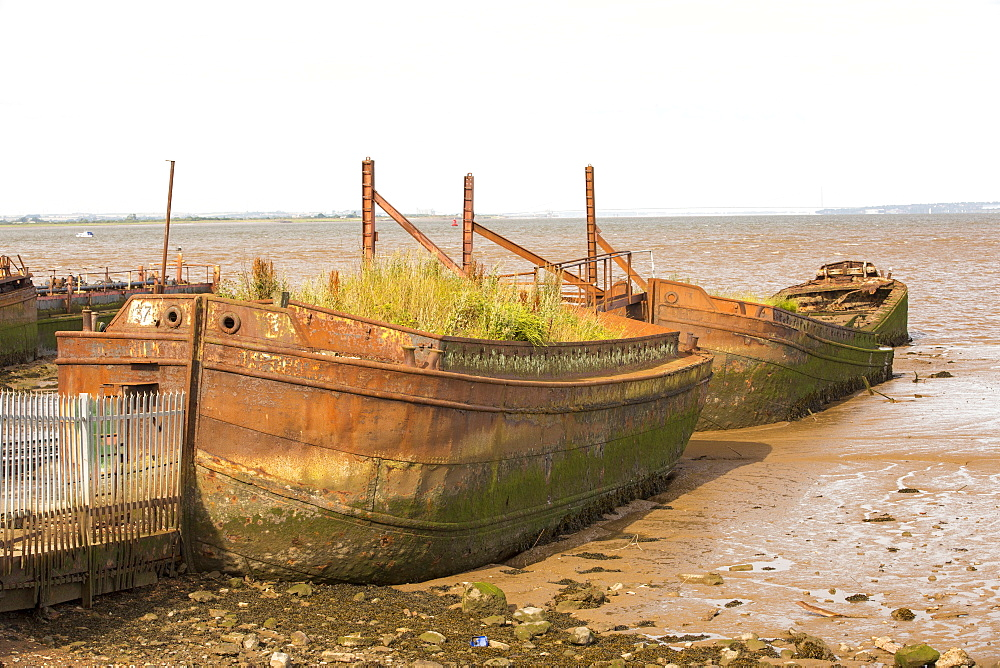 Old ship hulls being used to provide shelter to a ship yard at Salt End on the Humber Estuary, near Hull, Yorkshire, UK.