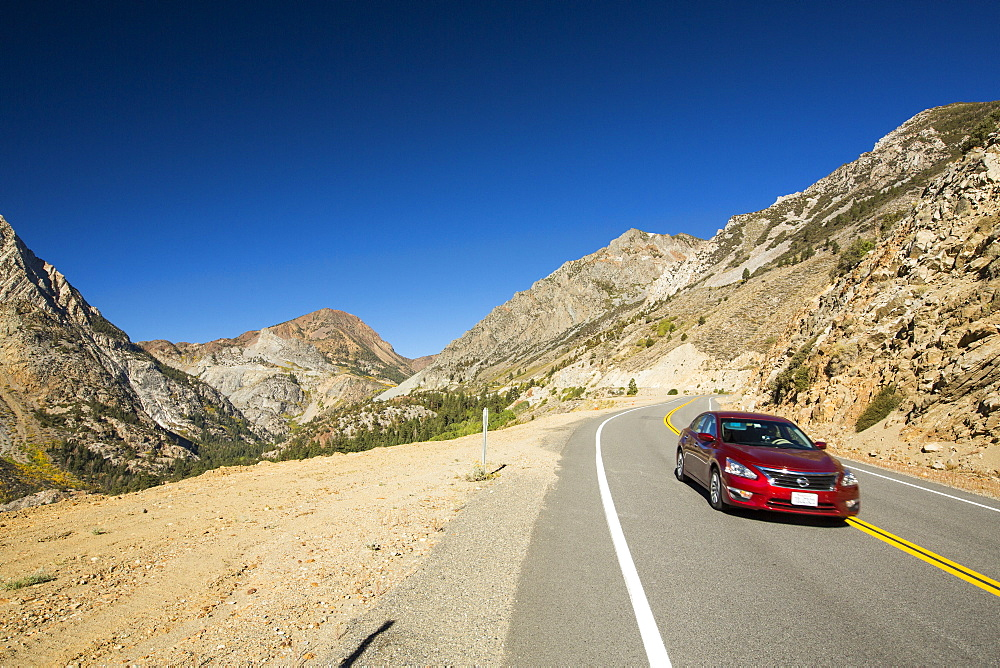 A car travelling from Lee Vining into Yosemite National Park, California, USA.