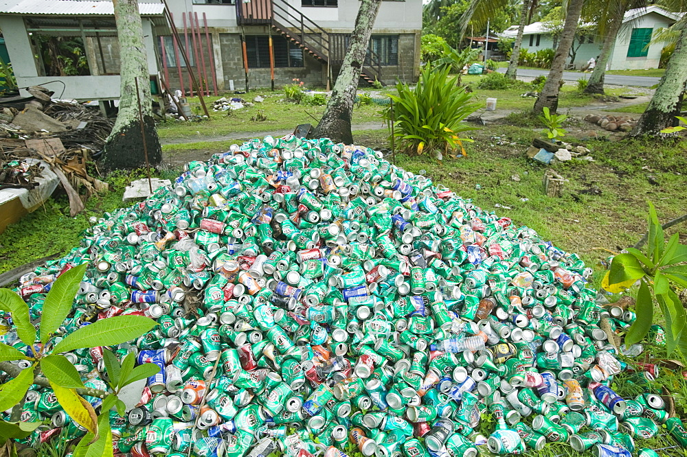 Beer cans piled up in a garden on Funafuti Atoll, Tuvalu, Pacific - 911-1028