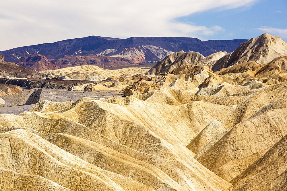 Badland scenery at Zabriskie Point in Death Valley which is the lowest, hottest, driest place in the USA, with an average annual rainfall of around 2 inches, some years it does not receive any rain at all.