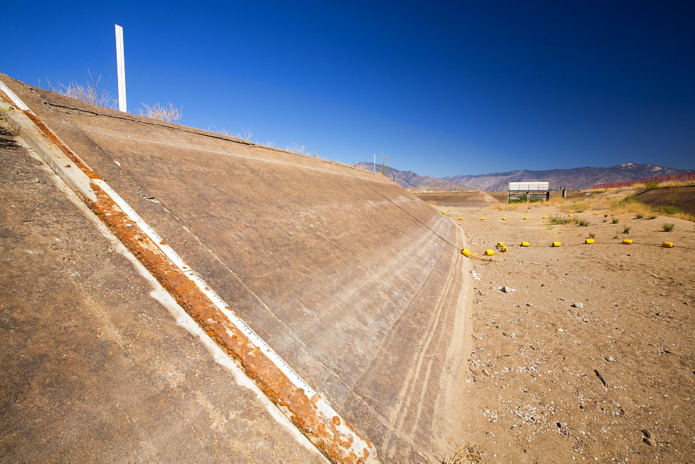 Lake Isabella near Bakersfield, East of California's Central valley is at less than 13% capacity following the four year long devastating drought. The reservoir has dropped so low, that the water level is below the outflow pipe, shown here.