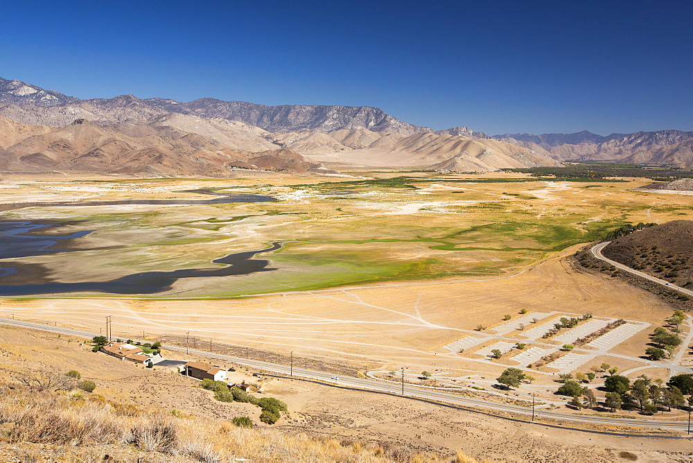Lake Isabella near Bakersfield, East of California's Central valley is at less than 13% capacity following the four year long devastating drought. The reservoir has dropped so low, that the water level is below the outflow pipe.