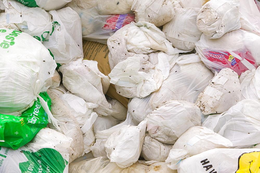 Piles of disposable nappies on Funafuti Atoll, Tuvalu, Pacific