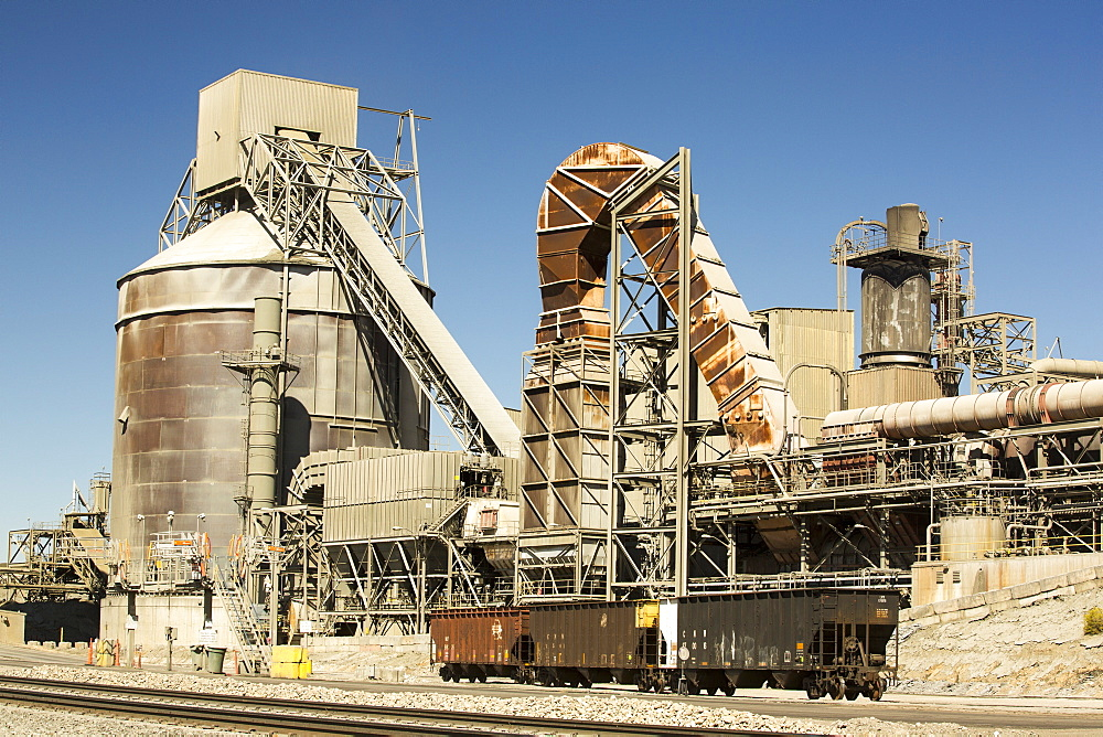 A cement works at Tehachapi Pass California, USA, Cement production is one of the most carbon hungry industrys on the planet.