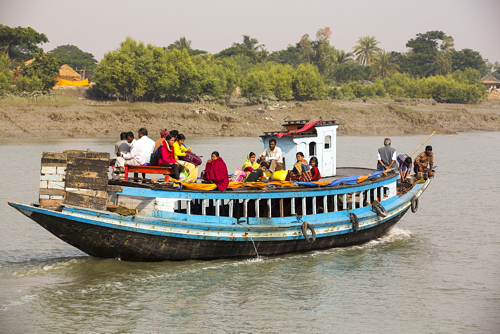 Boats carrying people and goods in the Sunderbans, a low lying area of the Ganges Delta in Eastern India, that is very vulnerable to sea level rise.