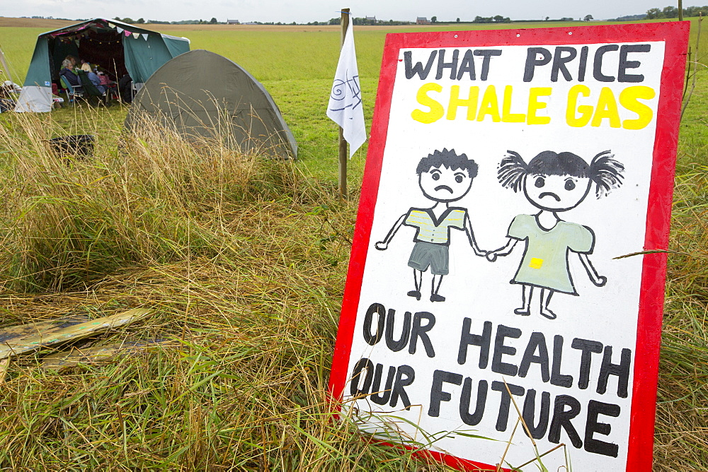 A protest banner against fracking at a farm site at Little Plumpton near Blackpool, Lancashire, UK, where the council for the first time in the UK, has granted planning permission for commercial fracking fro shale gas, by Cuadrilla.