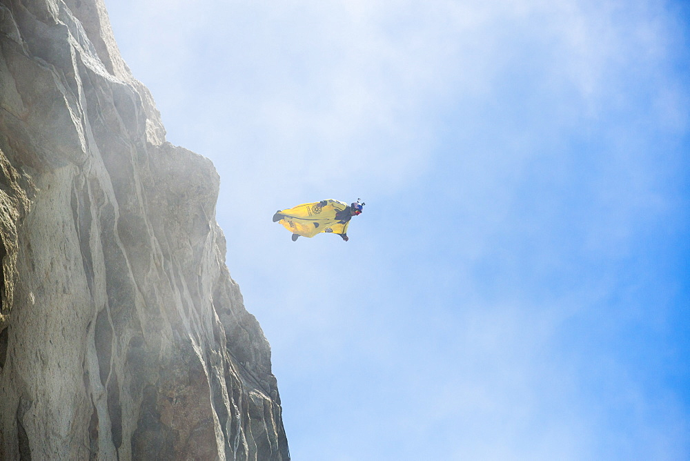 A base jumper wearing a wing suite jumps from the Aiguille Du Midi above Chamonix, France.