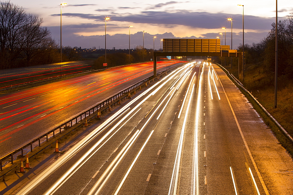 Rush hour traffic on the M6 Motorway near Preston, Lancashire, UK at dusk.