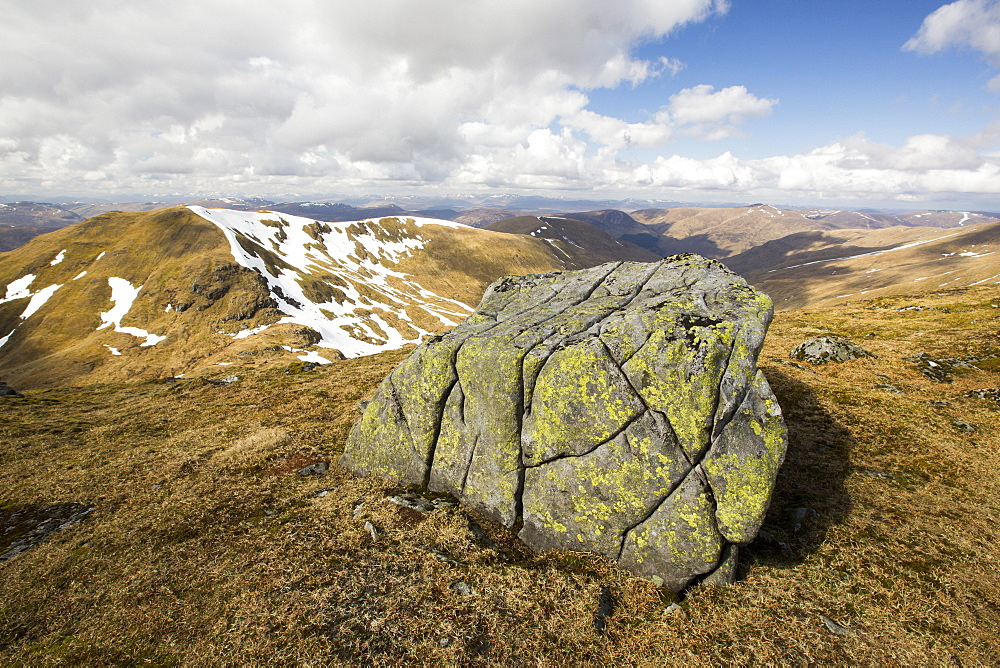 A lichen covered boulder on Beinn Ghlas, a Munro on the side of Ben Lawers.