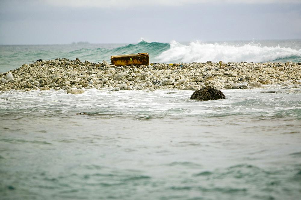 Approaching Tepukasavilivili island, completely destroyed by global warming sea level rise, off Funafuti, Tuvalu, Pacific