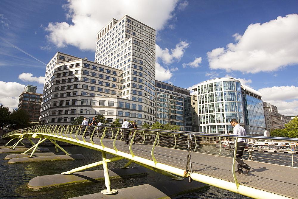 A bridge over docklands towards Canary wharf, London, UK.