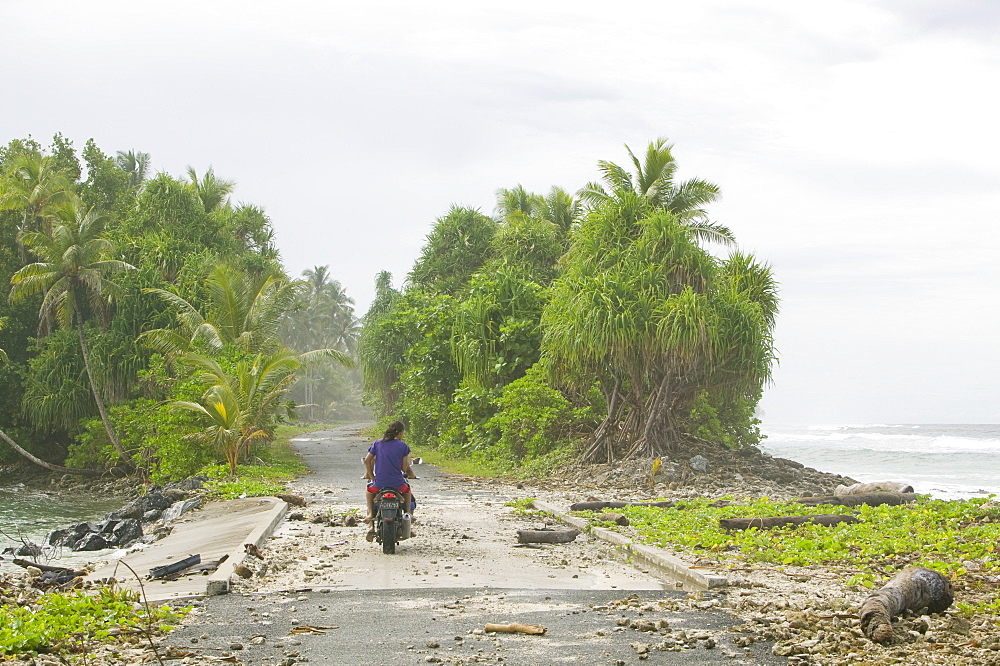 Tuvaluans watch as the high tide inundates their island home due to global warming induced sea level rise, Funafuti, Tuvalu, Pacific - 911-1059
