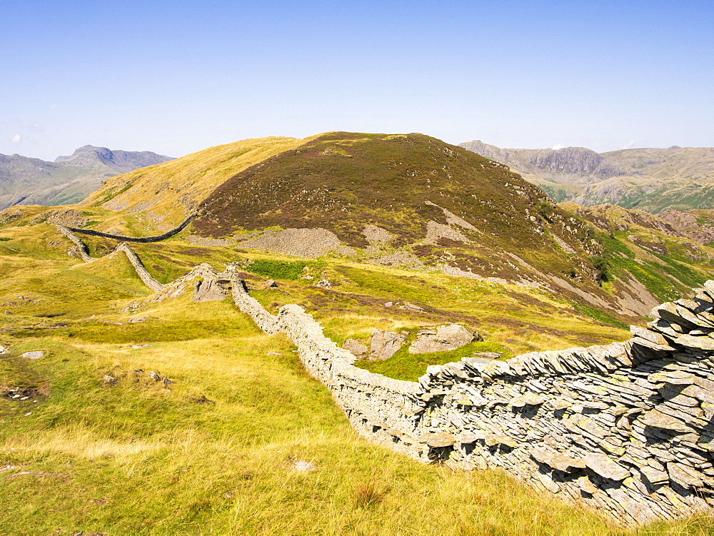A dry stone wall on Lingmoor above Langdale valley in the Lake District, UK.