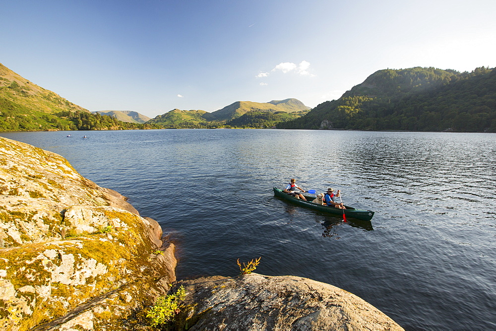A family paddling in a Canadian Canoe on Ullswater in the Lake District, UK. - 911-10609