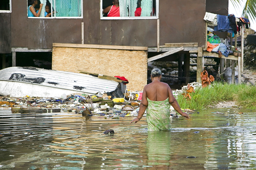 Houses flooded by sea water incursion due to global warming induced sea level rise that threatens the future of these low lying islands, Funafuti Atoll, Tuvalu, Pacific - 911-1063
