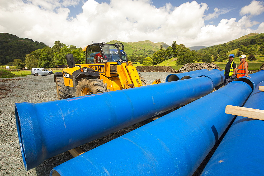 A lorry delivering hydro pipes for the New Rydal Hall Hydro electric scheme, Ambleside, Lake District, UK.