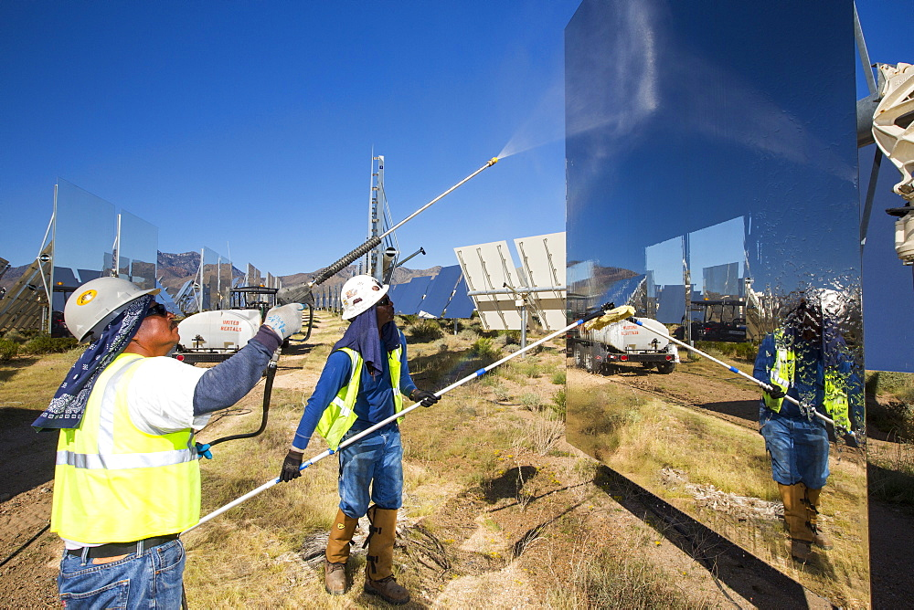 Workers washing the heliostats to maximise reflective power at the Ivanpah Solar Thermal Power Plant in California''s Mojave Desert is currently the largest solar thermal plant in the world. It generates 392 megawatts (MW) and deploys 173,500 heliostats that reflect the suns rays onto three solar towers. It covers 4,000 acres of desert. - 911-10693