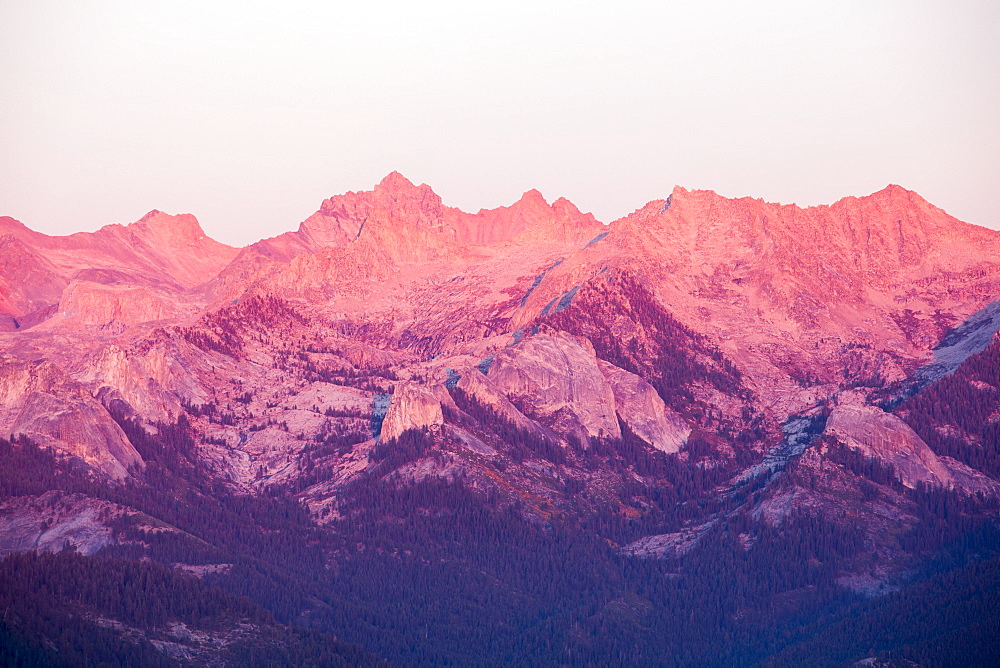 A Mountain chain view from the summit of Moro Rock a granite outcrop viewpoint in the Sequoia National Park, Yosemite, USA, at sunset.