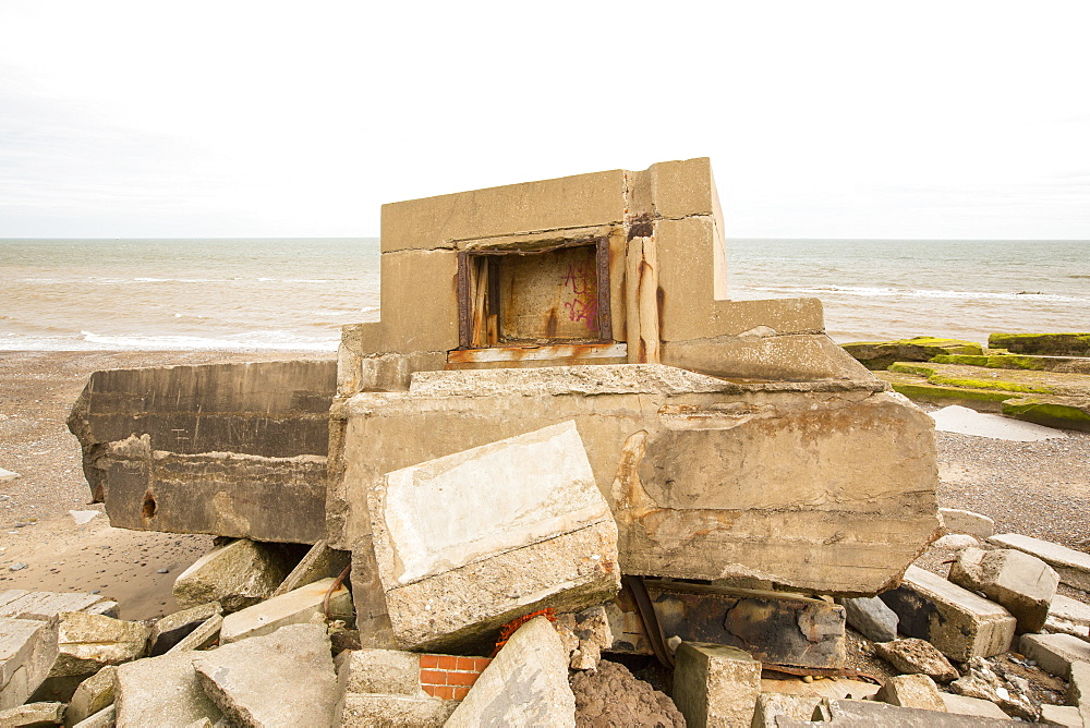 The Remains of the Godwin battery on the beach at Kilnsea at the head of Spurn point on Yorkshires East Coast, UK. Initially constructed during the First World War, the Godwin Battery was added to during the Second World War. It comprised of gun emplacements, search light, barracks, officers' mess, and a hospital. This section of coastline is the fastest eroding coastline in Europe. The soft boulder clay cliffs are easily eroded and have been eroding since Roman Times, but recently the climate change impacts of increased stormy weather, increased heavy rainfall events and sea level rise have accelerated the rate of erosion. The average rate of attrition is 1.5metres per year, last year it was 5 metres.