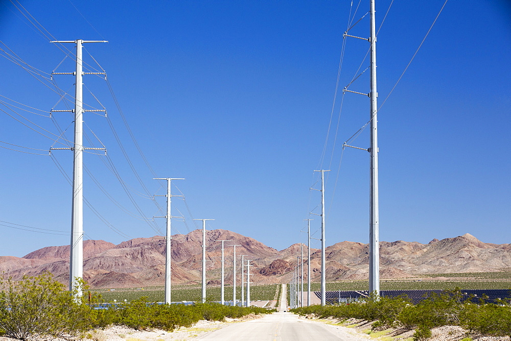 Pylons take renewable electricity from the Copper Mountain Solar power plant in Nevada, USA.